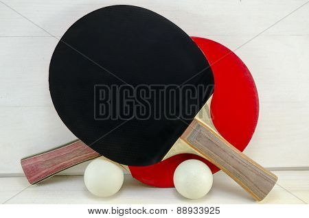 Two Table Tennis Rackets And Balls