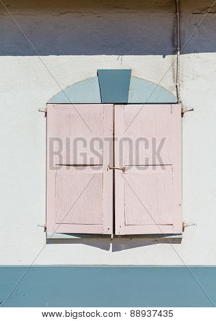 Pink Shutters On Stucco Wall