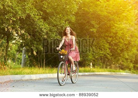 Young woman and bike