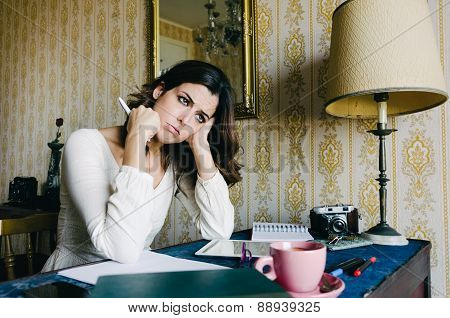 Overwhelmed Young Woman Working At Home
