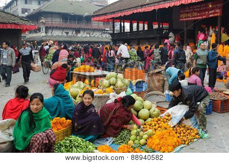 KATHMANDU,NEPAL,NOVEMBER 04,2010: Morning market activity in the Historical Patan Durbar square in Kathmandu, Nepal. This place has been heavily damaged the 25 April 2015 by a terrible earthquake.