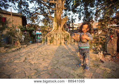 BHAKTAPUR, NEPAL - CIRCA DEC 2013: Unidentified child in the Central district of Bhaktapur. More 100 cultural groups have created an image of Bhaktapur as Capital of Nepal Arts.