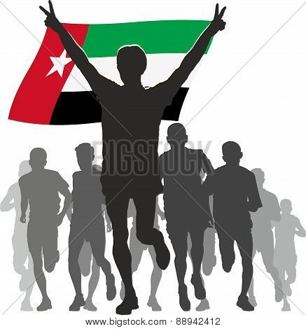 Athlete with the United Arab Emirates flag at the finish