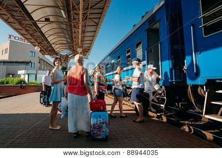 Unidentified people boarding on train on the station platform