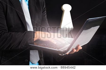 Business Man And Computer Laptop And Light From Key Hole Use For Working Solution Conception