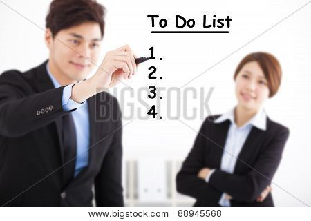 Businessman Writing To Do List For Business Plan  Concept