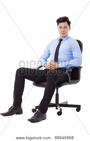 Young Businessman Sitting In A Chair Isolated