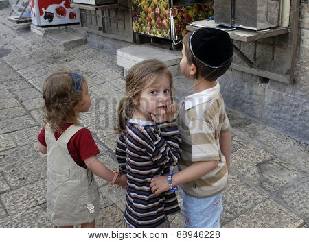 OLD CITY, JERUSALEM, ISRAEL - JUNE 11, 2007: Jewish children play in the streets of the Jewish Quarter located in the Old City of Jerusalem.