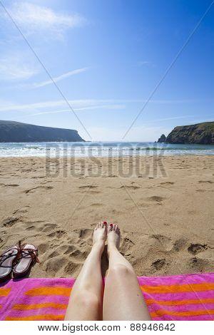 Legs On A Beach Towel