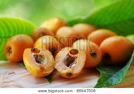 Loquat medlar and leaves on on table