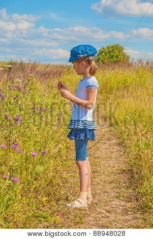 Little girl in the meadow