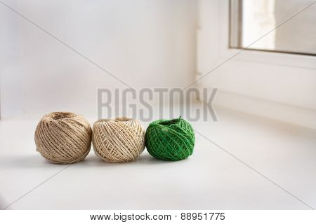 Three Skeins Of Thread In A Row