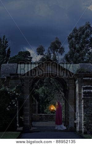 Lady in castle garden at night