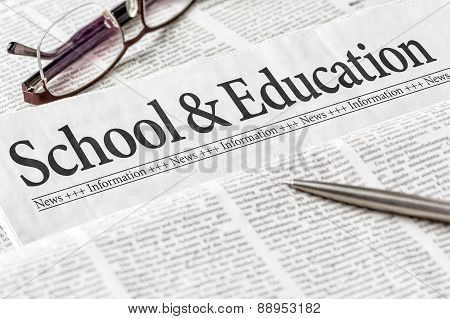 A Newspaper With The Headline School And Education