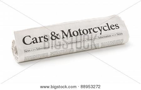 Rolled Newspaper With The Headline Cars And Motorcycles