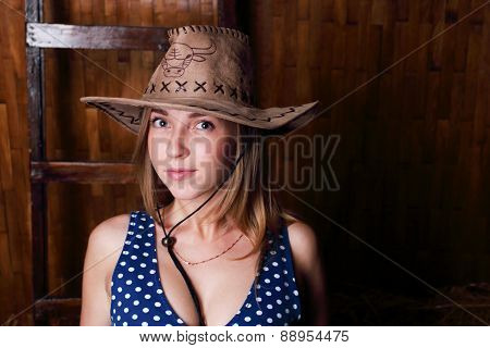 Closeup Of Beautiful Young Smiling Girl With Long Blond Hair Wearing Cowboy Hat