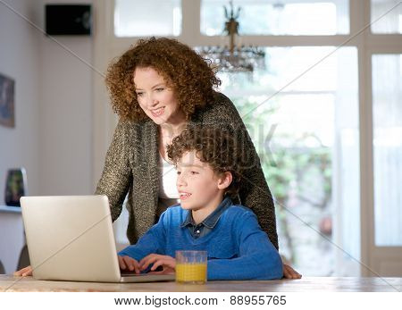 Mother And Son Using Computer At Home