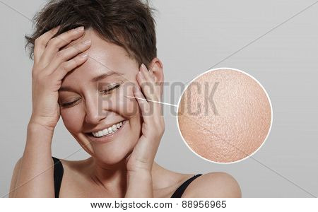 Happy Woman With A Lens Showing Her Ideal Skin