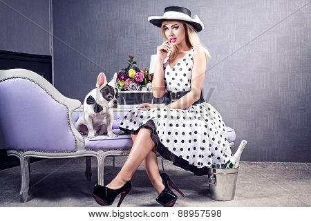 Elegant Blonde Woman Posing With Pug Dog.