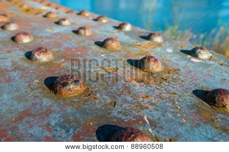 Rusty Rivets In An Old Bridge From Close
