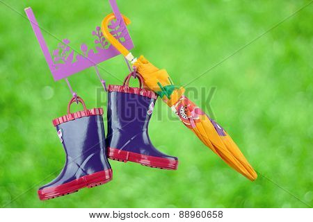 Pair Of Fashion Rubber Child Boots  Hanging With Yellow Umbrella