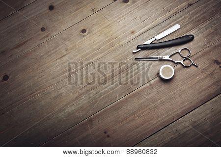 Vintage Barber Equipment On Wood Background