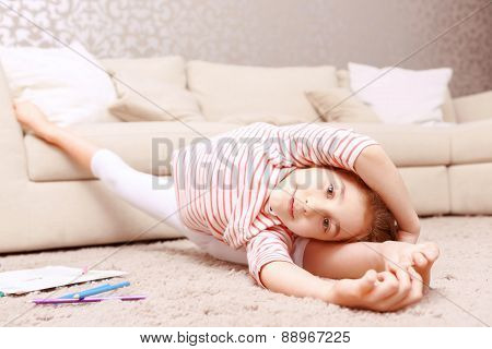 Little girl doing gymnastic