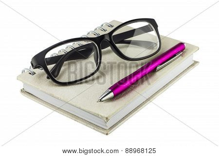 Notebook , Pen And Eyeglass On White Background