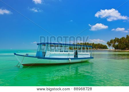 Tropical island and boat - nature travel background
