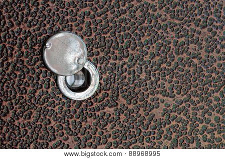 Old Peephole On The Metal Door