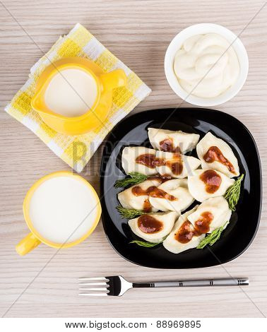 Dumplings In Plate, Mayonnaise, Towel, Jug And Cup Of Milk, Top View