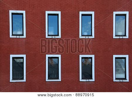 Eight Windows On Red Brick Wall