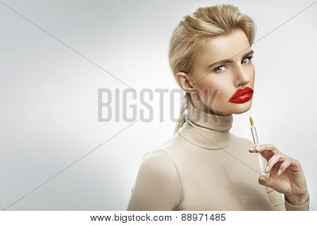 Exaggerated injection to the lips of a beautiful blonde