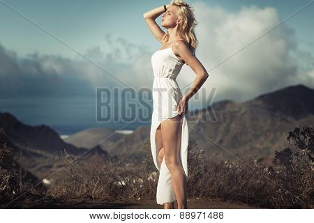 Blonde beauty on summer vacation day