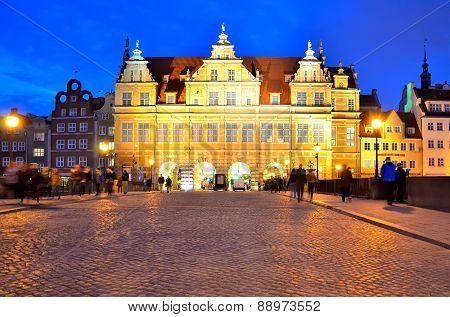 Green Gate at Dlugi Targ square in Gdansk at night.
