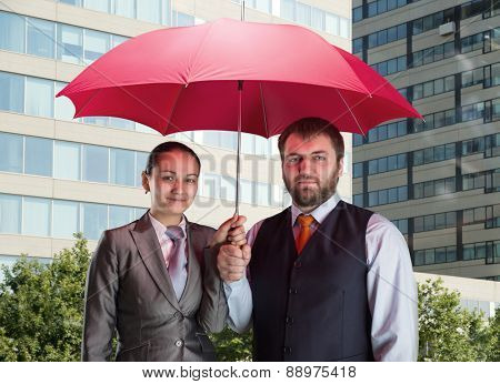 Business team under umbrella