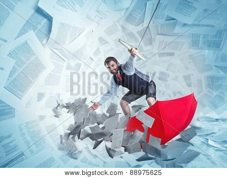 Confident businessman is surfing on red umbrella