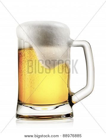 Mug of light beer with foam