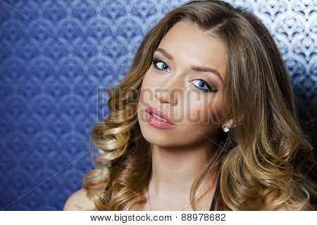 Beauty portrait of young attractive woman, isolated on dark background