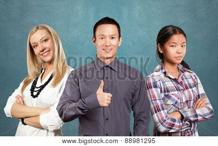 Team and young woman with crossed hands standing against different backgrounds