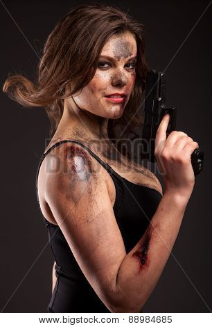 Sexy woman with gun. Riot girl