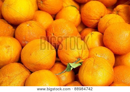 Pile Of Organic Oranges At Market Stall