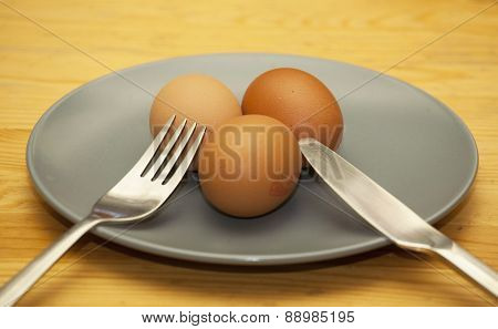 Real Plain Easter Eggs On Plate With Knife And Fork