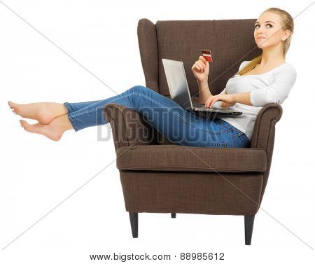 Young woman with laptop and credit card isolated