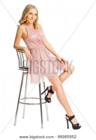 Young girl on chair isolated