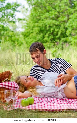 Young couple on picnic at forest