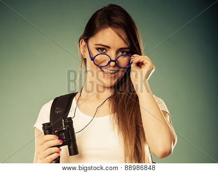 Tourist Woman With Binocular Looking Through Glasses