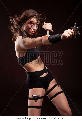 Killer woman with knife. Riot girl. Posing in studio.