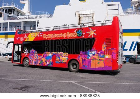 MGARR, GOZO ISLAND, MALTESE ISLANDS - APRIL 17, 2015: Touristic tour coach, sightseeing bus in Mgarr city, Mgarr Gozo, Malta