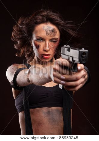 Sexy woman with military, riot uniform in studio with gun